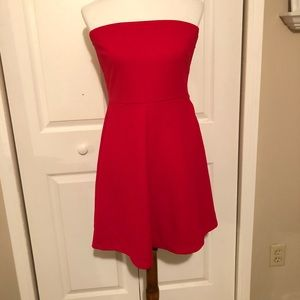 Limited red strapless dress.
